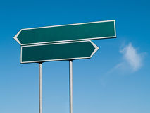 Double signpost. Double green signpost in the blue sky Stock Photo