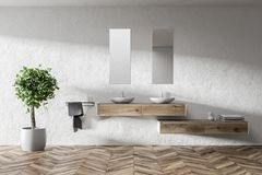 Double sink in a white bathroom. Double bathroom sink standing on a wooden shelf in a white wall room with two narrow vertical mirrors above it. 3d rendering royalty free illustration