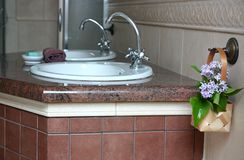 Double sinks in a marble countertop. In the bathroom Royalty Free Stock Photo