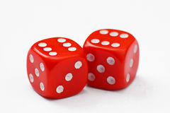 Double six dice. Pair of red dice thrown to a double six, isolated on a white background Stock Photography
