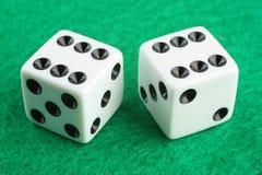 Double Six Dice. A pair of dice scoring double six over green felt macro closeup Stock Image