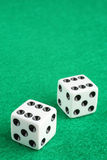 Double Six Dice. A pair of dice displaying double six over green felt macro closeup. Copy space available royalty free stock images