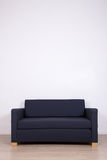 Double sofa in room over white wall with copy space Royalty Free Stock Photos
