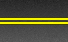 Double solid yellow lines on asphalt Stock Photography