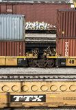 St. Louis, Missouri, United States-circa 2018-double stack container freight train well cars on railroad tracks in trainyard. Double stack container freight Royalty Free Stock Photography