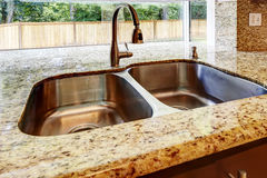 Double steel sink with and granite top. CLose up view Stock Photography