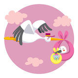 Double Stork Delivery. Stork flying delivering a newborn baby stork that carries a little baby mouse for delivery Royalty Free Stock Image