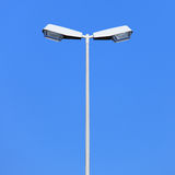 Double street lamp post on blue sky background Royalty Free Stock Photography