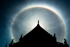 Double sun halo behind  the roof. Royalty Free Stock Photography