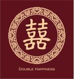 Double symbole chinois de bonheur dans le cadre floral rond Images libres de droits