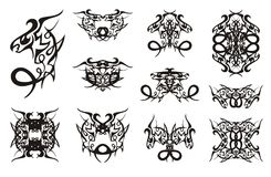 Freakish dragon symbols with curls. Double symbols of the young coiling peaked dragon for your design. Black on white Stock Image