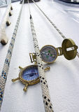 Double take. Ropes and compasses for sailing Royalty Free Stock Image