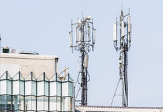 Double Telecommunication tower on the building Stock Images