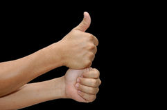 Double Thumbs up. In black stock images