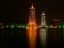 Double tower. In dim light of night Royalty Free Stock Photo