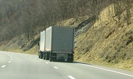 Semi Truck Driving Through The Mountains Stock Photos