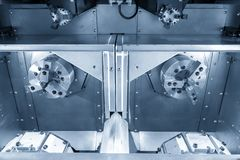 The double turret CNC lathe machine. Or turning machine. Hi-technology manufacturing process royalty free stock image