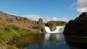 Double waterfall falling between basalt rocks in Iceland Stock Photo