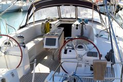 Double wheel sailboat stern deck area moored Royalty Free Stock Photo
