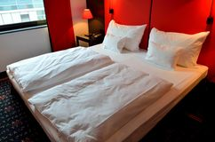Double white bed inside the hotel room Royalty Free Stock Photography