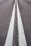 Double white lines on road Royalty Free Stock Images