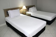 Double white mattress and black bed royalty free stock images
