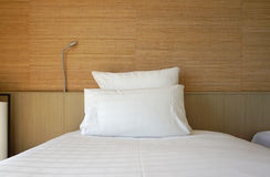 Double white pillow on white bed sheet Stock Image