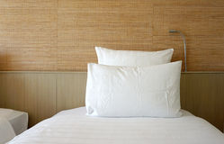 Double white pillow on white bed sheet Royalty Free Stock Photography