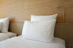 Double white pillow on white bed sheet Royalty Free Stock Image