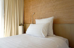 Double white pillow on white bed sheet Stock Photography