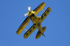 Double-wing airplane. Yellow double-wing airplane is giving a airshow, fly by Stock Images