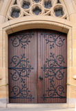 Double wooden church doors set in sandstone archway Stock Photos