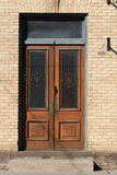 Double Wooden Doors in Brick Building Stock Images