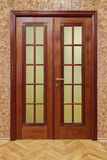 Double wooden doors with cork wallpaper and flooring. Wooden doors with cork wallpaper and flooring Royalty Free Stock Image