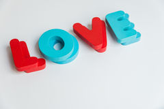 Double Wooden word LOVE on White background Stock Photo