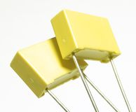 Double yellow. Two yellow high voltage capacitors Royalty Free Stock Image