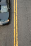 Double Yellow with Car Royalty Free Stock Image