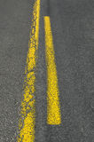 Double yellow line on asphalt road Royalty Free Stock Photography