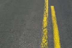Double yellow line on asphalt road. Royalty Free Stock Photo