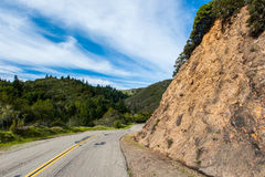 Double yellow line down windy mountain road Stock Image