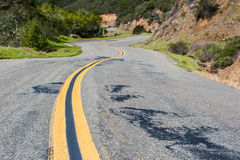 Double yellow line down windy mountain road Royalty Free Stock Images
