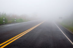 Double yellow line with fog. On the road Stock Image