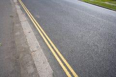 Double yellow line on London street Stock Image