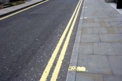 Double yellow line on London street Stock Photos