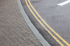 Double yellow line on street Royalty Free Stock Photo