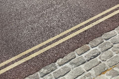 Double yellow line on street Stock Images