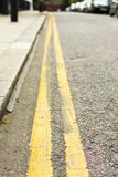 Double yellow lines. Close view of double yellow lines at the side of a road Royalty Free Stock Image