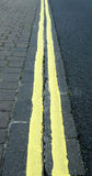 Double yellow lines. Double yellow line dissapering into the distance Royalty Free Stock Photos