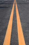 Double yellow lines Stock Images