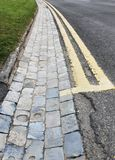 Double Yellow Lines & Brick Drainage Channel Stock Images
